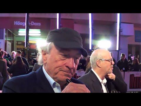 ROBERT DE NIRO signs 'Taxi Driver' poster 4 charity @ The Intern premiere, London