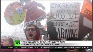 Gesture of solidarity as teachers strike worldwide