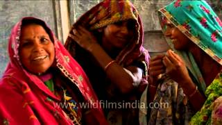 Rajasthani women stitch Zari embroidery