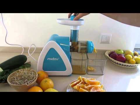 Midzu slow juicer making orange juice