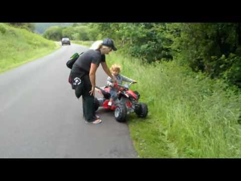 Review new kids raptor 12v ride on battery electric quad for Motorized quad for toddler