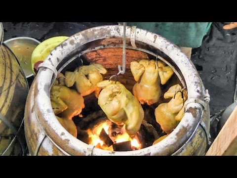 Chickens Roasted in Charcoal Oven. Street Food of Bangkok, Thailand