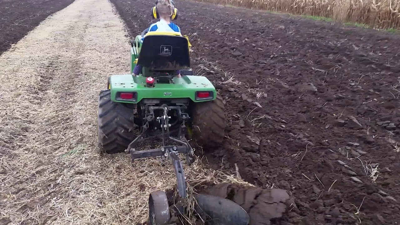 Daughter on John Deere 332 plow tractor by Trav