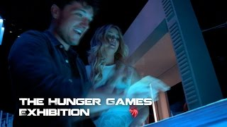 Behind The Scenes: Jennifer Lawrence And Josh Hutcherson At The Hunger Games Exhibition