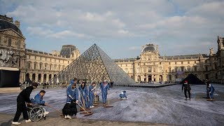 French artist JR surrounds Louvre Pyramid with giant collage