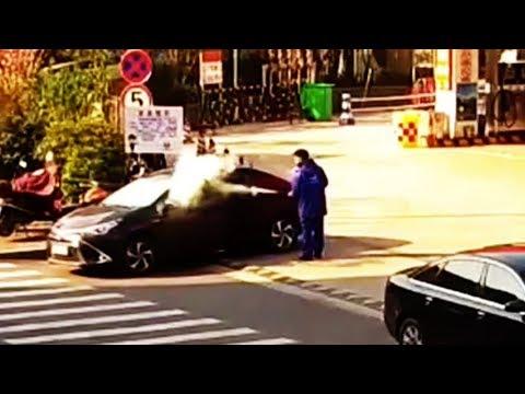 Petrol station worker sprays fire extinguisher to stop smoker