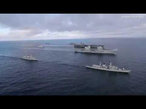 Britains HMS Queen Elizabeth sails alongside Americas