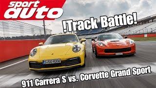 track battle porsche 911 992 carrera s vs corvette grand sport sport auto