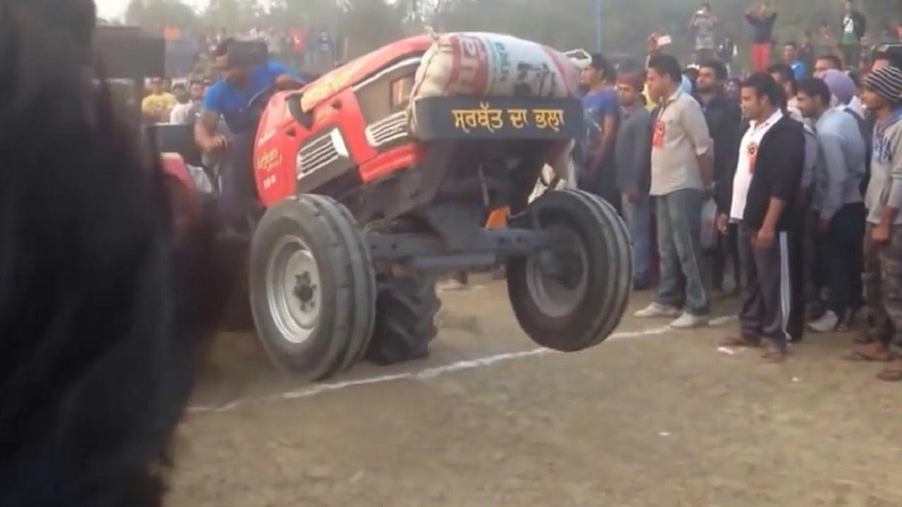 Bullet vs Tractor Stunts John deere royal enfield Bullet Farmtrac in Punjab