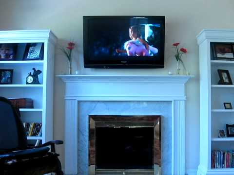 Plasma TV mounted over fireplace