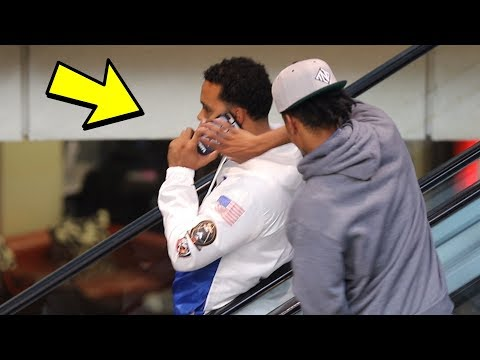 STEALING PEOPLES PHONES ON A ESCALATOR!