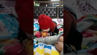 Sweet indian kid trying to eat apple