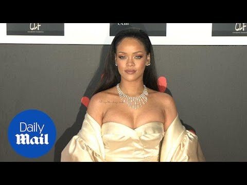 Rihanna flashes cleavage in show-stopping gown at Diamond Ball - Daily Mail