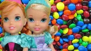 CANDIES ! ELSA & ANNA toddlers have fun sliding, hiding, jumping, playing in CANDIES!