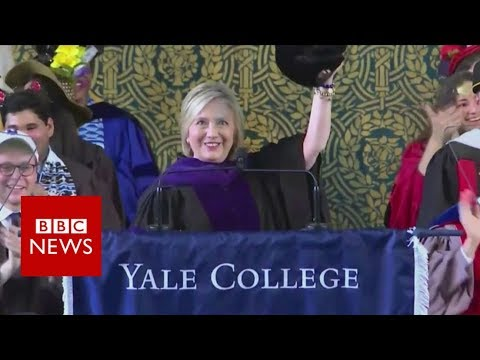 Clinton brings Russian hat to ceremony - BBC News