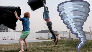 TORNADO lifts dad off ground.... Or maybe just strong wind and he jumped