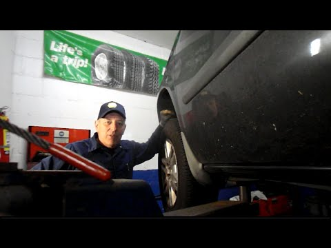How to replace the front axle on a 2006 Dodge Caravan