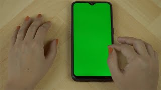 Slow-motion shot of woman hands using her mobile during office hours in India
