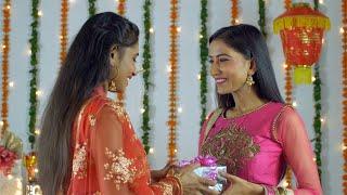 Two Indian sisters greeting each other on the occasion of Diwali festival