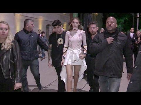 Gigi Hadid and Zayn Malik shows PDA leaving the Givenchy Fashion Show