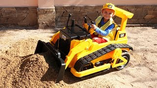 The Car stuck in the sand - Dima unboxing power wheels Buldozer CAT