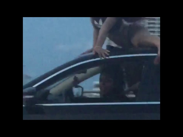 Damn! Woman Twerks On Roof of a Car While Car Is Driving In Miami Highway