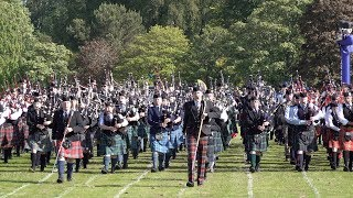 Finale of the 2019 Aberdeen Highland Games in Scotland with parade by the massed Pipes and Drums