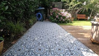 Nicole's turning old concrete gravel pavers into a great Portuguese patio