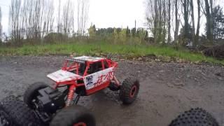 RC Monster truck rock crawler going through mud, deep water, gets stuck off-roading
