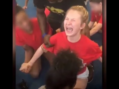 CAUGHT ON CAMERA: DENVER CHEERLEADER SCREAMS IN AGONY AS THE COACH FORCES HER INTO A SPLIT!!