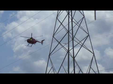 Helicopter pulling draw wire for power line