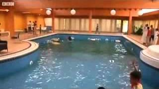 Libyan rebels enjoy Aisha Gaddafi's luxurious apartment indoor Pool