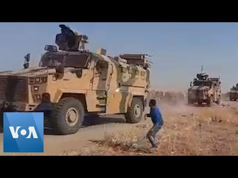 Syrian Kurds Throw Rocks At Passing Turkish Military Convoy In Northern Syria