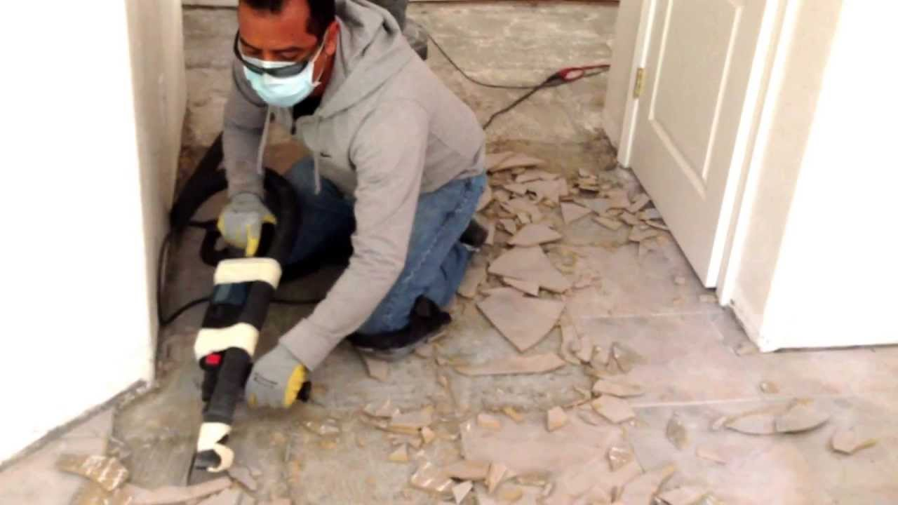 One easy way to remove ceramic tile from concrete youtube dailygadgetfo Images
