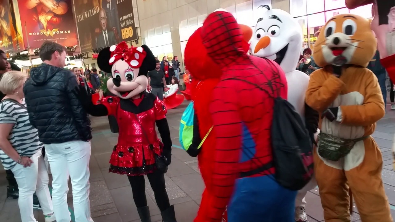 cartoon characters and acrobats times square off youtube