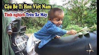 Cậu Bé Tí Hon K'Rể Tinh Nghịch trên chiếc xe máy của Bố - Vietnamese Little Boy