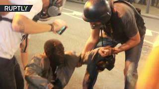 RAW  Man in wheelchair knocked over by police vehicle during Rio protests