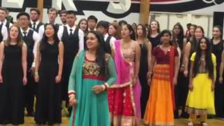 amador valley high school choir orchestra performing the song barso re at a local dandiya event