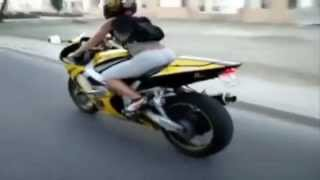 Motorcycle stunts , girls on bikes
