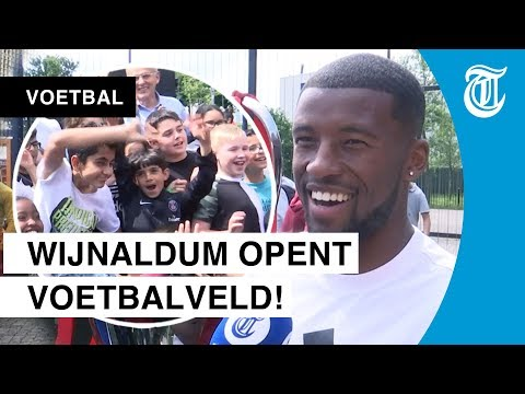 Wijnaldum opening his own Cruyff Court in Rotterdam. Bringing the Champions League cup with him. - In Dutch -