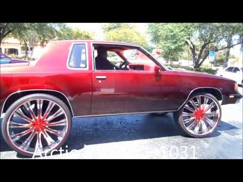 "AceWhips.NET- ARCTIC Customs- Female's Candy Red Oldsmobile Cutlass on 28"" Bentchis"