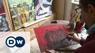 لاجئ سوري رسام يعرض أعماله لأول مرة في ألمانيا | الأخبار
