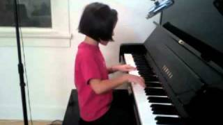 8-year-old plays piano & sings Octopus