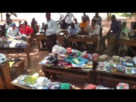 Rotarians work, donate school supplies