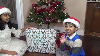 Opening Christmas Presents Is Fun - We Even Donated Two Gifts To Toys For Tots.