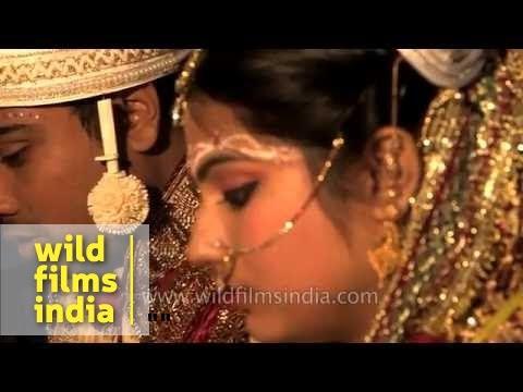 Hindu priest chants holy mantras: Bengali wedding