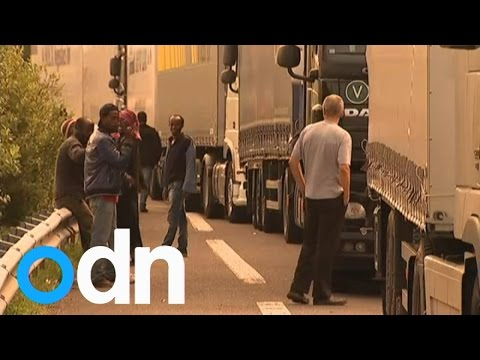 Migrants try to board UK bound trucks amid Calais chaos