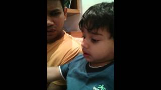 Dev and papa reading dictionary