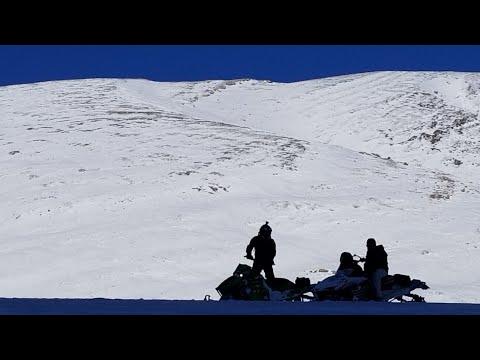 ALBERTA SLEDDING DEEP SNOW