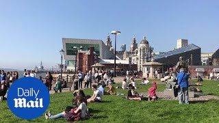People enjoy the bank holiday sunshine by Liverpool's River Mersey - Daily Mail